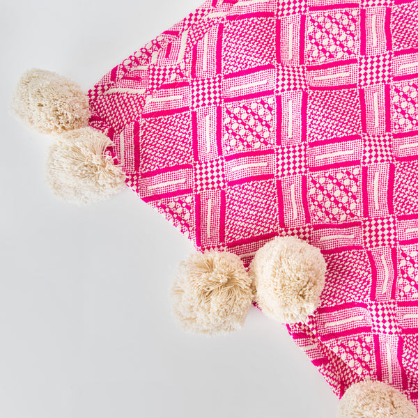Handmade pink throw with pompoms