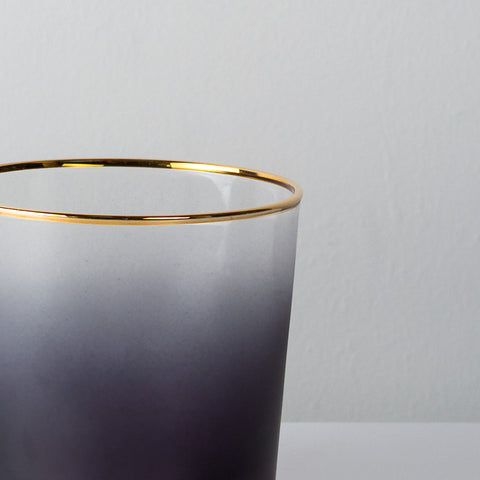 Gold rimmed grey glass votive