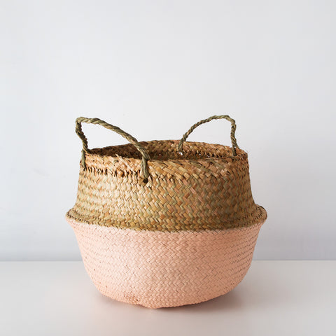 Wicker storage basket with dusty pink base
