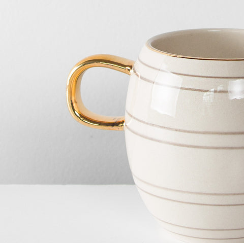 Gold handle glazed mug