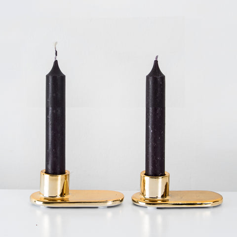 Gold glazed candlestick holder