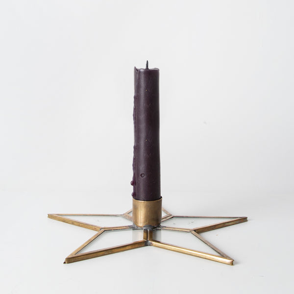Brass and glass star candlestick holder