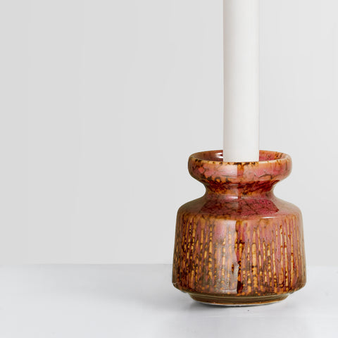 Rust red glazed candlestick holder