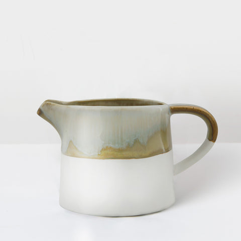 Handcrafted earth glazed milk jug