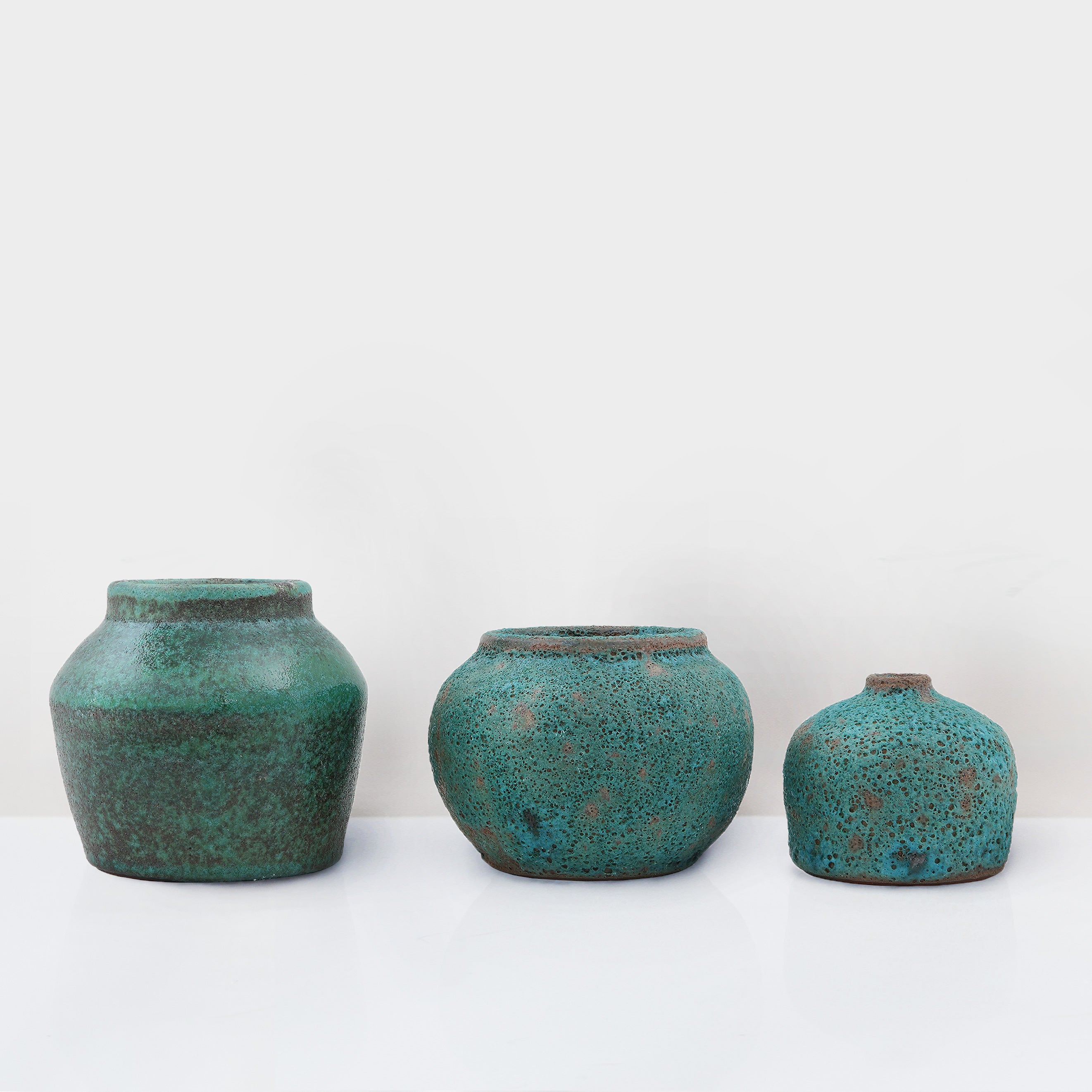 Set of three handcrafted terracotta decorative pots