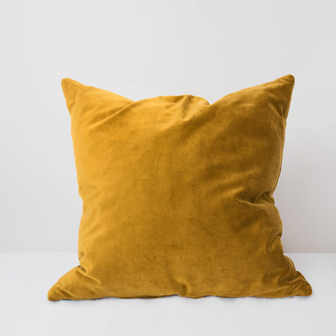 Amber yellow velvet cushion