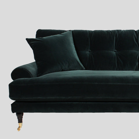 Emerald green velvet sofa