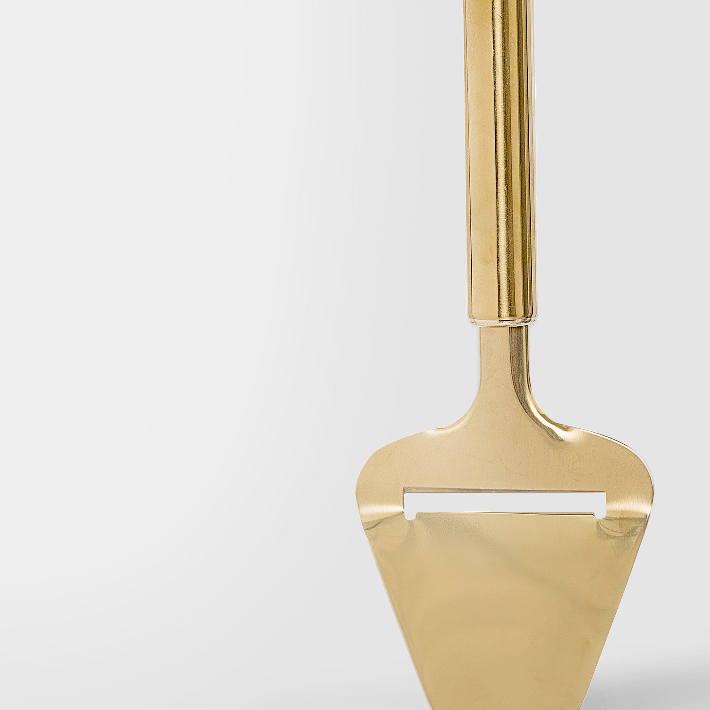Gold tone cheese slicer