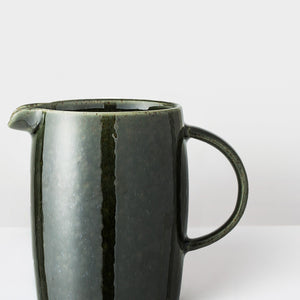 Handcrafted forest green glazed stoneware milk jug