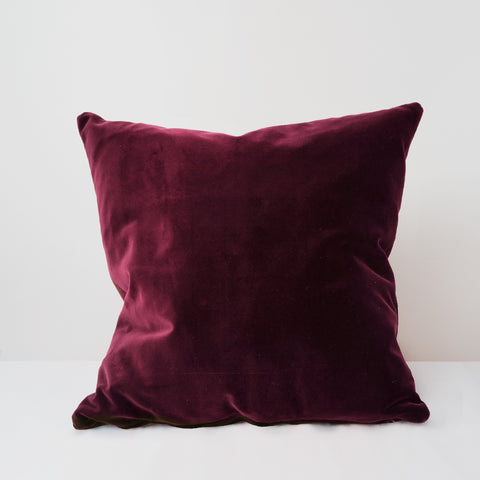 Ruby red velvet cushion