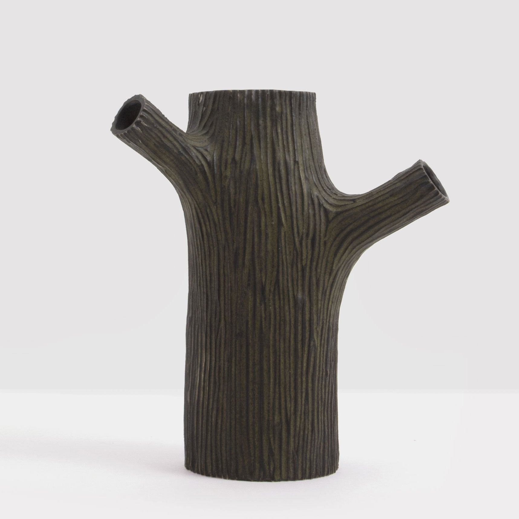 Handmade decorative stump in matt black by Caro Gates