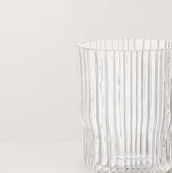 Clear ribbed drinking glass