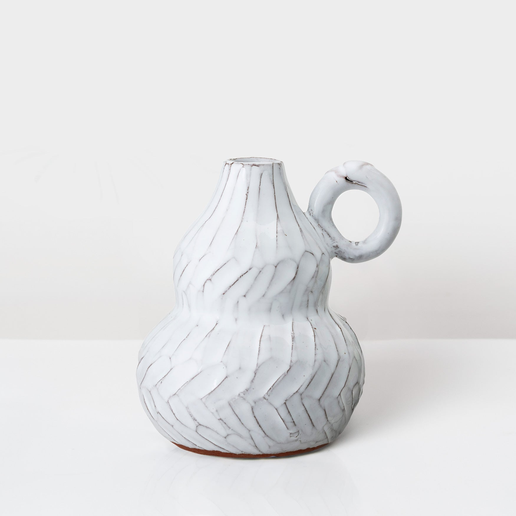 White glazed terracotta decorative vase