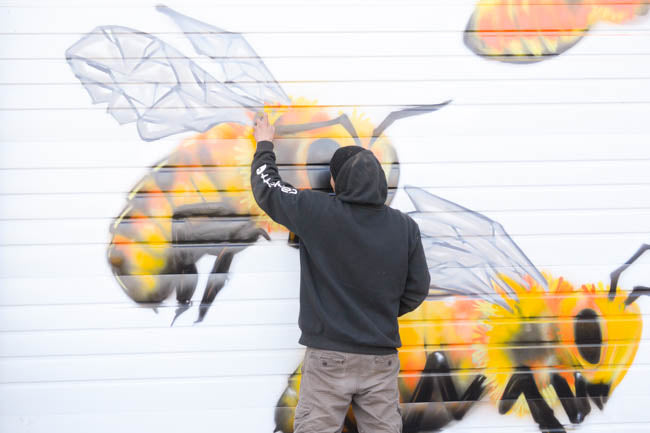 Honeybee Mural at Old Blue Raw Honey by artist Manny Arechiga