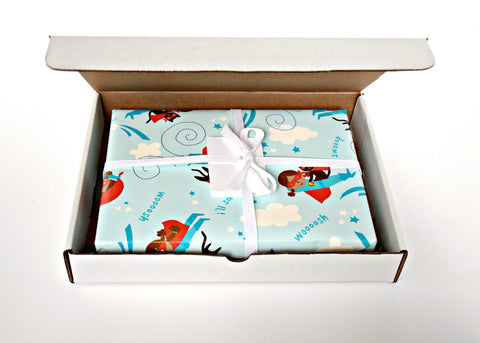 super girl wrapping paper in a box
