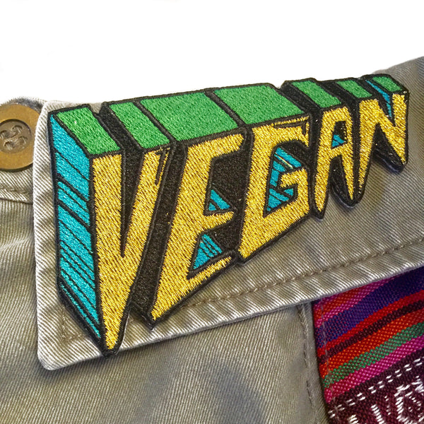 Embroidered Vegan patch in gold, green & turq. Iron on