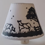 Lamp shade with image of UFO.