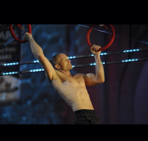 Brian Arnold competes on the rings on American Ninja Warrior