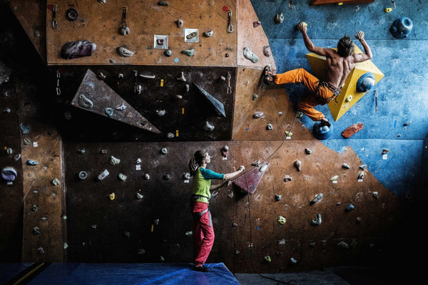 lead climber climbing in gym