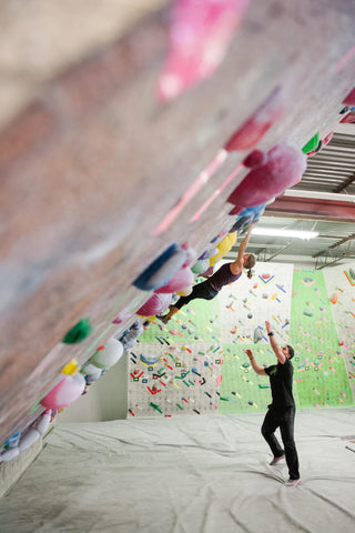 Neely Quinn of TrainingBeta training at an indoor climbing gym