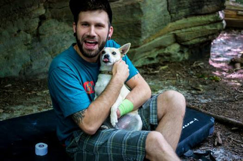 Jon Sedor with his dog at the crag