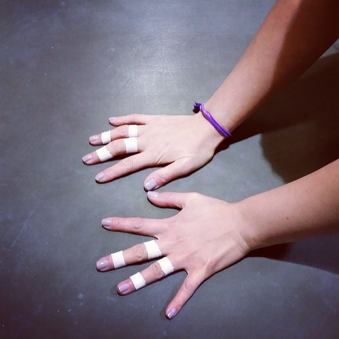 Bouldering Babes taped climber hands