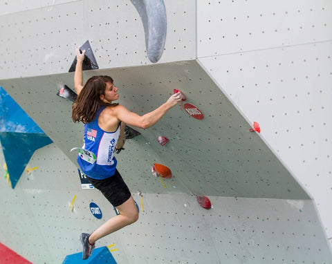 Zoe Steinberg climbing in a bouldering competition
