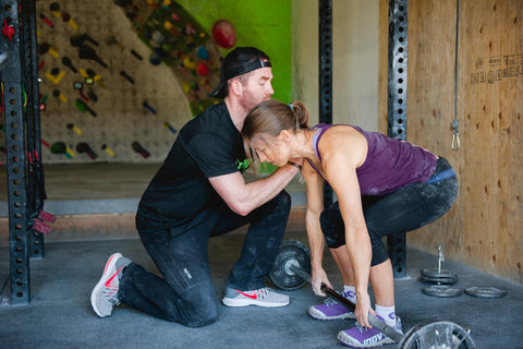 Neely Quinn of TrainingBeta trains in the gym with Kris Peters
