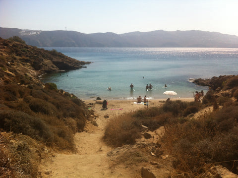 the sun on Agios Sostis beach, Myconos, Greece