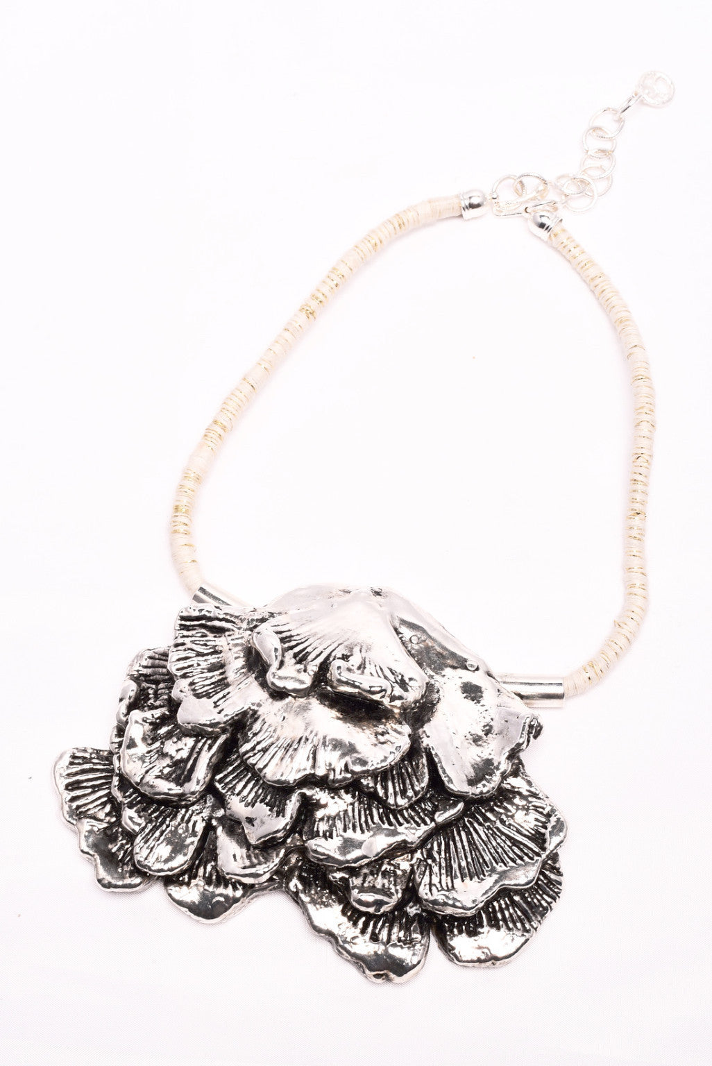 seaweed in silver antique plated necklace with white/gold cotton cord Design by Alexandra Koumba