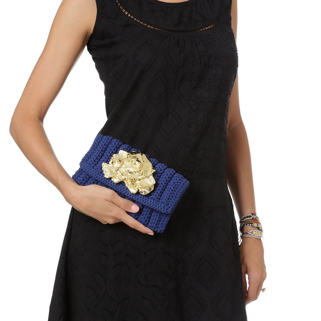 blue clutch in lycra with gold seaweed designed by Alexandra Koumba
