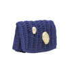 Petalides in gold on a Purple Lycra clutch designed by Alexandra Koumba