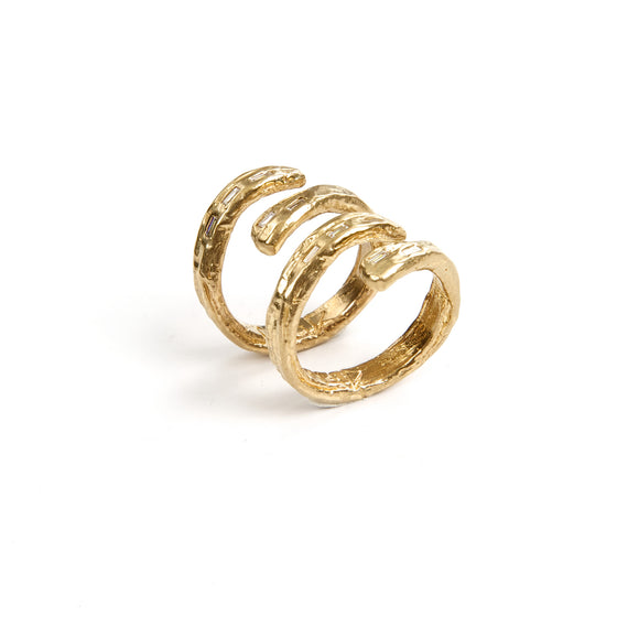 Spine Ring Set in gold with five white diamond baguettes Design by Alexandra Koumba