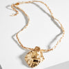 crab-wrap-necklace-beige-raffia-gold-designed-by-alexandra-koumba