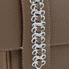 this is the waterproof signature chain's detail hand stitched designed by Alexandra Koumba