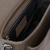 view of the interior pocket of the Signature Messenger bag by Alexandra Koumba in taupe leather and silver chain