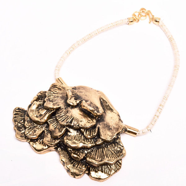 seaweed in gold plated necklace and white/gold cord Designed by Alexandra Koumba