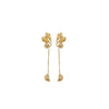 seed hang earrings in gold designed by alexandra koumba