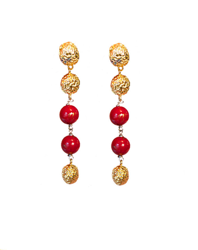 seed drop earrings coral designed by alexandra koumba