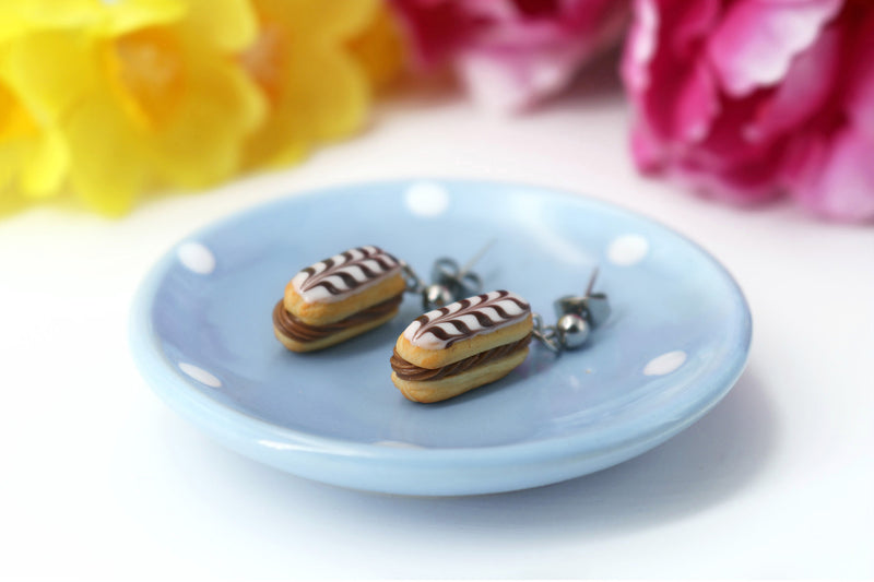 products/handmade_polymer_clay_stuffed_eclair_stud_earrings_with_choco_whipped_cream_1.jpg