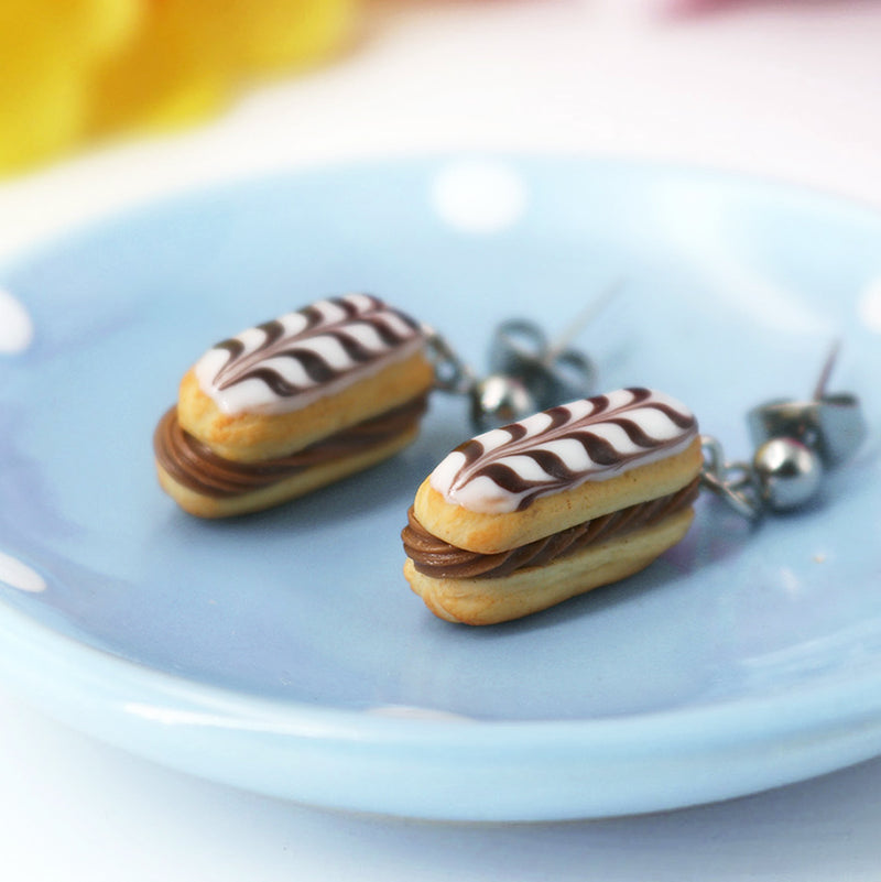 products/handmade_polymer_clay_stuffed_eclair_stud_earrings_with_choco_whipped_cream_crop.jpg
