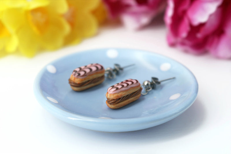 products/handmade_polymer_clay_stuffed_eclair_stud_earrings_with_chocolate_whipped_cream_1.jpg