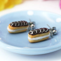 PolinaCreations Handmade jewelry Stuffed chocolate Eclair Stud Earrings with white stripes Eclair earrings polina creations raspberry earrings raspberry jewelry red jewelry red earrings fake food jewelry miniature food jewelry mini food earrings cute earrings cute jewelry dessert jewelry hypoallergenic earrings chocolate jewelry chocolate earrings gift for her gift for girl woman pastry earrings pastry charm pastry jewelry food charm chocolate eclair earrings chocolate glaze with white stripes