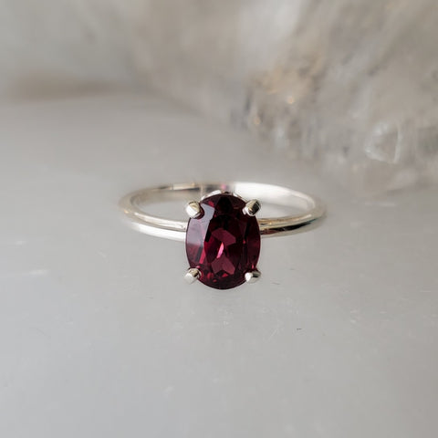 The Garnet Solitaire Scroll Ring