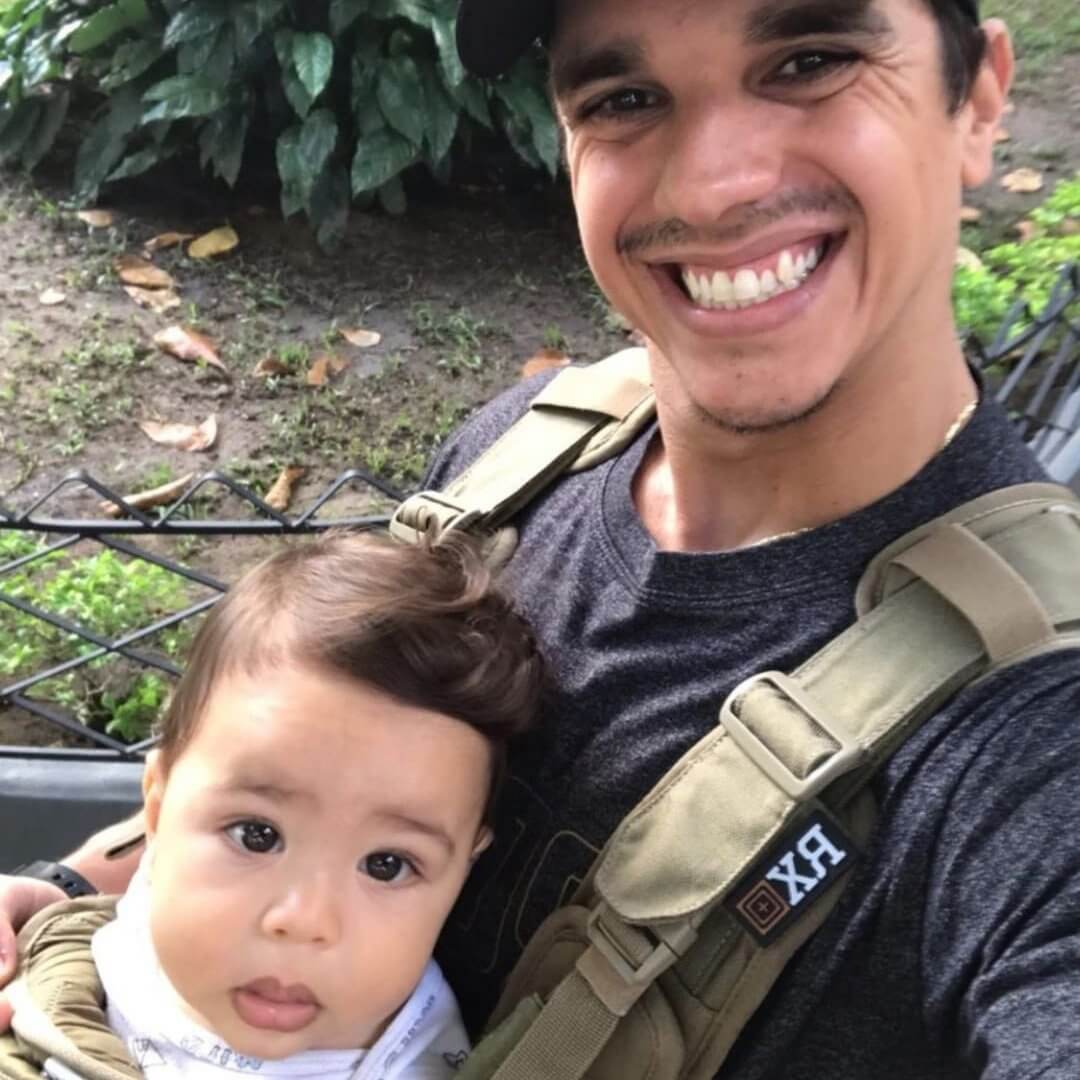 Baby and Dad Wearing the S.01 Action Baby Carrier - Mission Critical