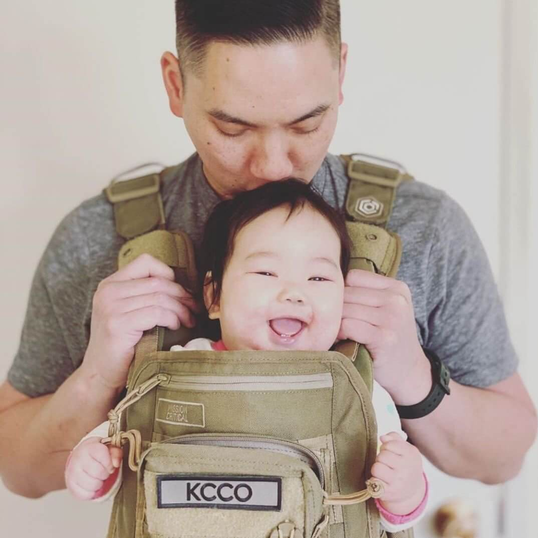 Dad and Baby in the S.01 Tactical Style Baby Carrier - Mission Critical