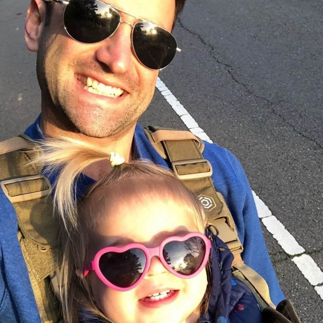 Dad and Baby Wearing the S.01 Baby Carrier - Mission Critical