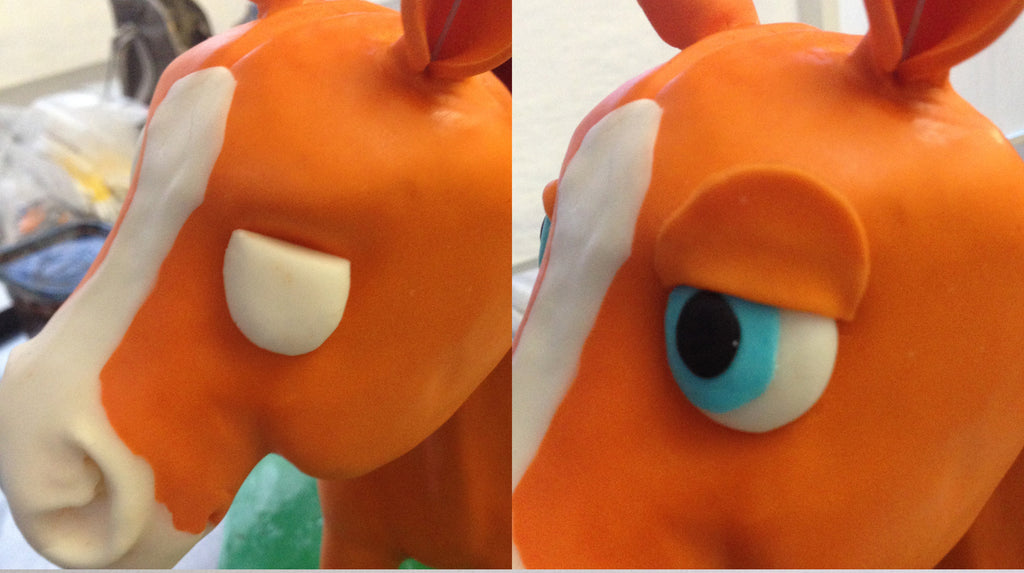 Finishing touches on a pony cake