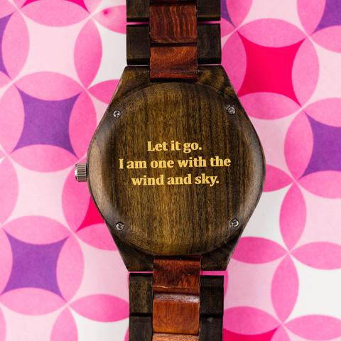 """Let It Go. I am one with the wind and sky."" Frozen lyric engraving on a wood watch."