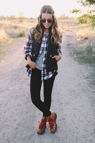 Hiking Boots Styled with a Flannel Shirt, Leggings, and a Warm Vest